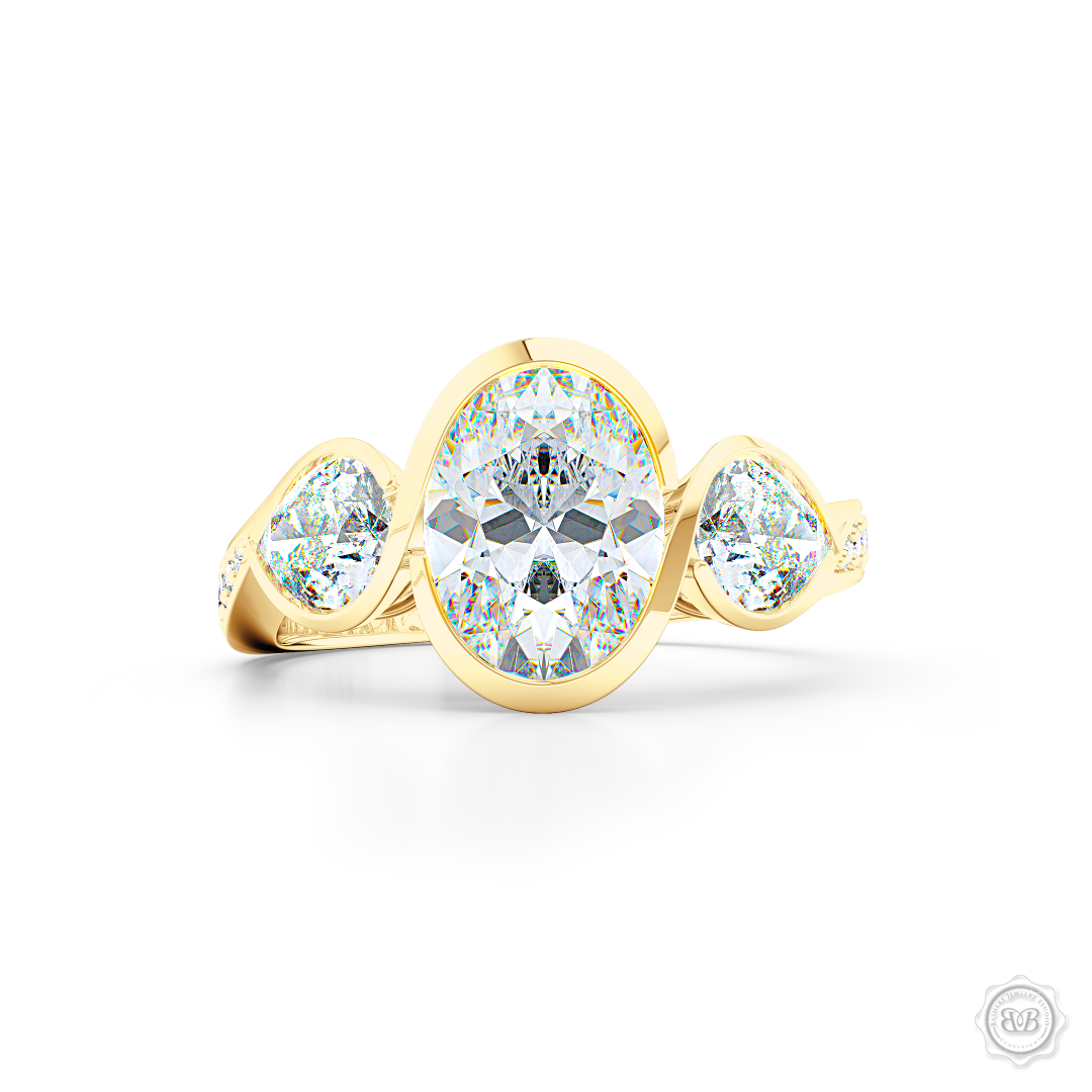 Three stone Moissanite engagement ring. Oval Cut Forever One Moissanite by Charles & Colvard. Pear shape side stone Moissanites. Handcrafted in Classic Yellow Gold. Free Shipping on All USA Orders. 30-Day Returns | BASHERT JEWELRY | Boca Raton, Florida
