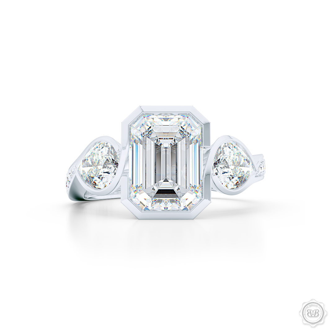 Three stone Moissanite engagement ring. Emerald Cut Forever One Moissanite by Charles & Colvard. Pear shape side stone Moissanites. Handcrafted in White Gold or Precious Platinum. Free Shipping on All USA Orders. 30-Day Returns | BASHERT JEWELRY | Boca Raton, Florida