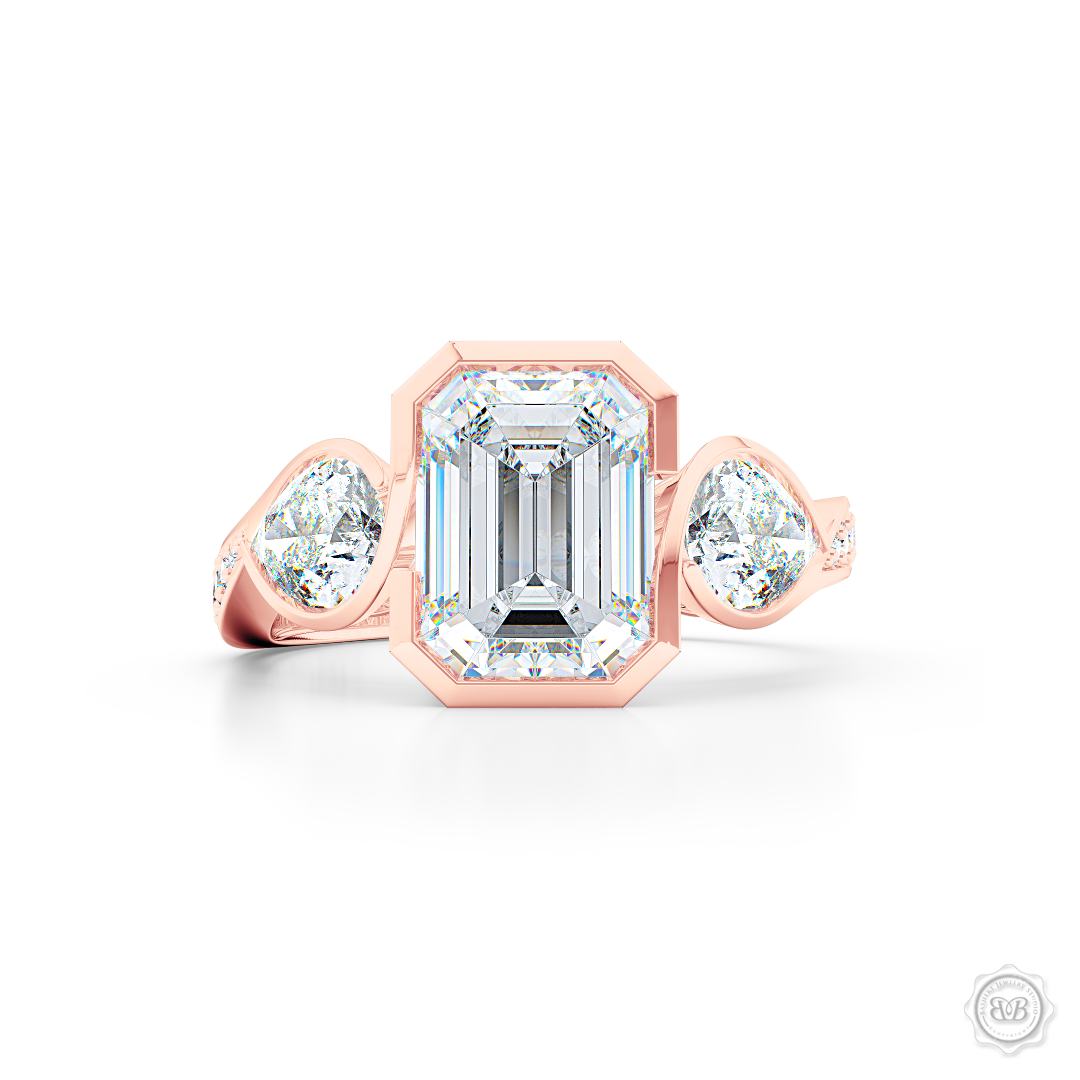 Three stone Moissanite engagement ring. Emerald Cut Forever One Moissanite by Charles & Colvard. Pear shape side stone Moissanites. Handcrafted in Romantic Rose Gold. Free Shipping on All USA Orders. 30-Day Returns | BASHERT JEWELRY | Boca Raton, Florida