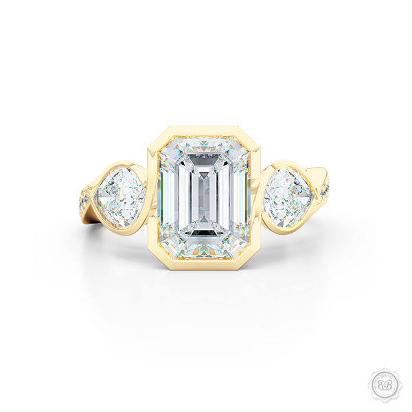 Three stone Moissanite engagement ring. Emerald Cut Forever One Moissanite by Charles & Colvard. Pear shape side stone Moissanites. Handcrafted in Classic Yellow Gold. Free Shipping on All USA Orders. 30-Day Returns | BASHERT JEWELRY | Boca Raton, Florida