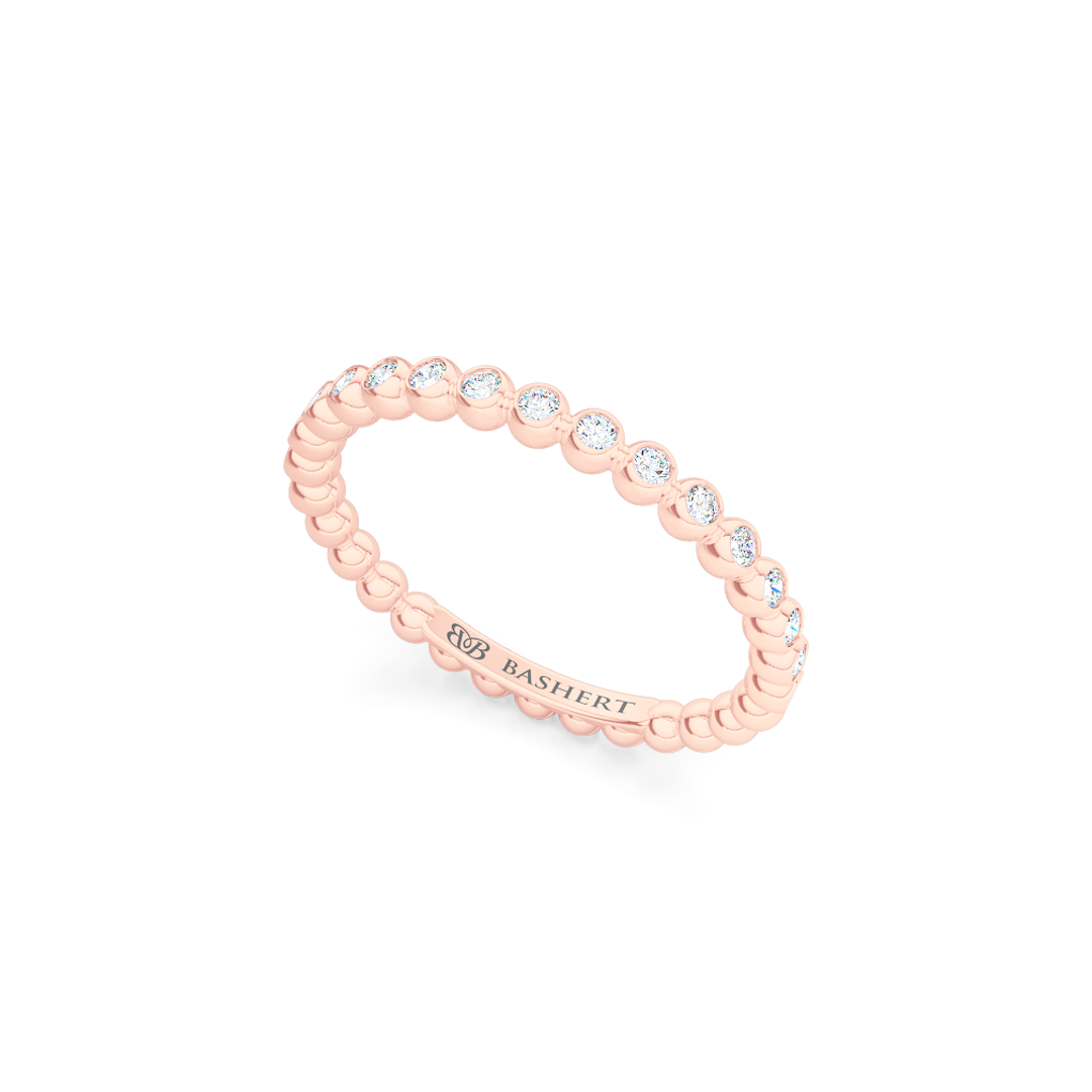 Delicate, bezel-set pots diamond wedding band. Hand-fabricated in solid, sustainable Rose Gold and premium quality Round, Brilliant Diamonds. Free Shipping for All USA Orders. 15-Day Returns | BASHERT JEWELRY | Boca Raton, Florida