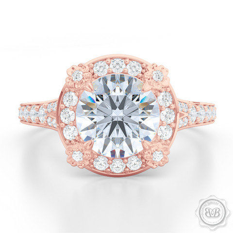 Award-Winning Round Halo Engagement Ring, crafted in Romantic Rose Gold and round brilliant Moissanite by Charles & Colvard. Signature Floret Prongs, Encrusted with Round Diamonds. Dazzling Baby-Split Bead-Set Shoulders. Free Shipping USA. 30Day Returns | BASHERT JEWELRY | Boca Raton Florida