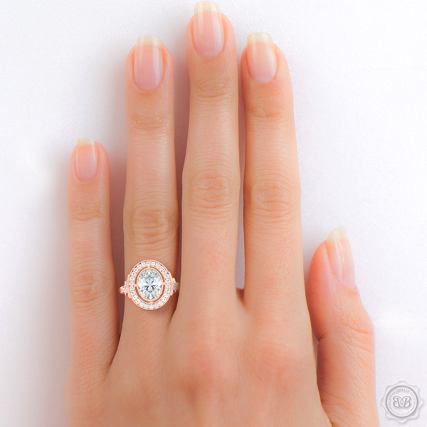 A Vintage Inspired Floating Halo Engagement Ring. Handcrafted in Romantic Rose Gold. Oval GIA certified Diamond. Classic french milgrain. Refine art-deco silhouette. Free Shipping on All USA Orders. 30-Day Returns | BASHERT JEWELRY | Boca Raton, Florida