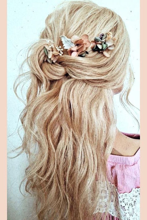 Wedding bridal hairstyle with flower hair accessories