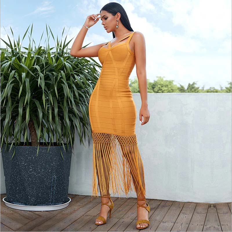 Our premium Treat Me Right yellow bandage midi dress features a cross front strappy detail, back zip fastening and split hem, with a shimmery maxi fringe overlay. Style with some golden earrings and high heels; a match made in heaven.