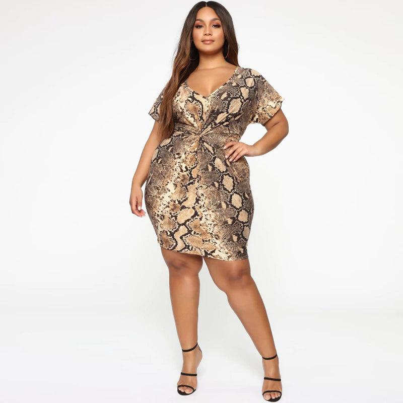 Your weekend outfit is finally sorted out with our bodycon Running Wild Dress. Featuring a brown snake print mesh fabric with 1/2 sleeves and centred ruched detailing. Team this with heels and a mini bag to complete the look.