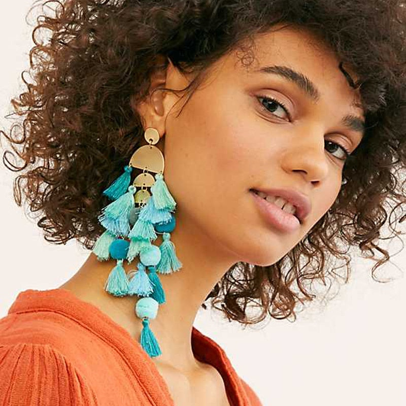 We are crushin' over these must have blue Think Again Earrings featuring acrylic rustic gold boho detailing and chandelier style tassel drops. Team with a strappy bodycon or floaty maxi dress for a cool summer party vibe.