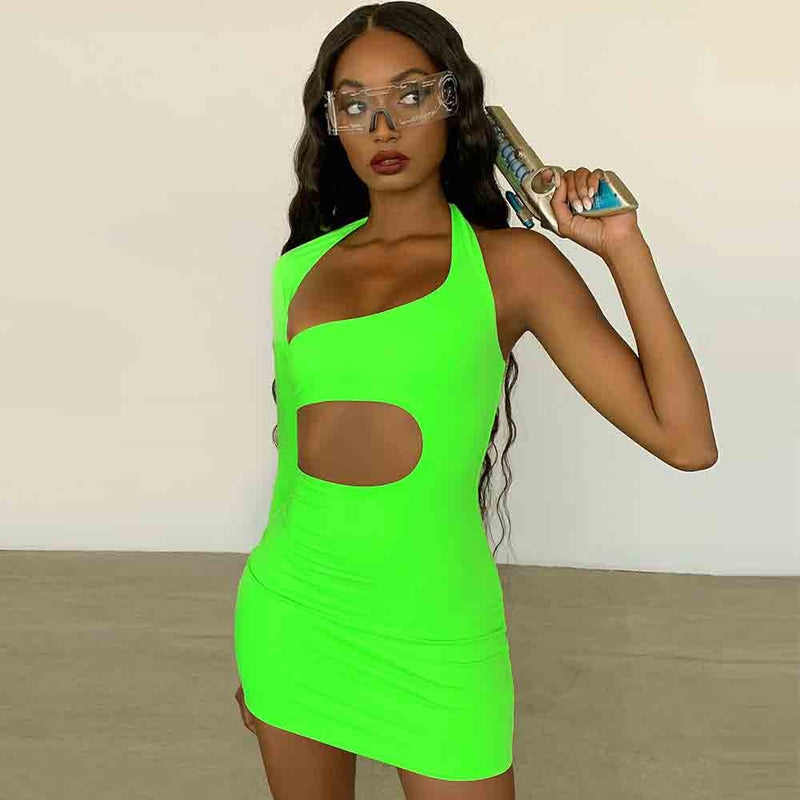 The Cut Me Out Mini Dress is made of a slinky fabric with a bodycon fit. The dress features asymmetric cut-outs that flatter the body. Style with barely there heels and a pendant necklace for a look we're loving.