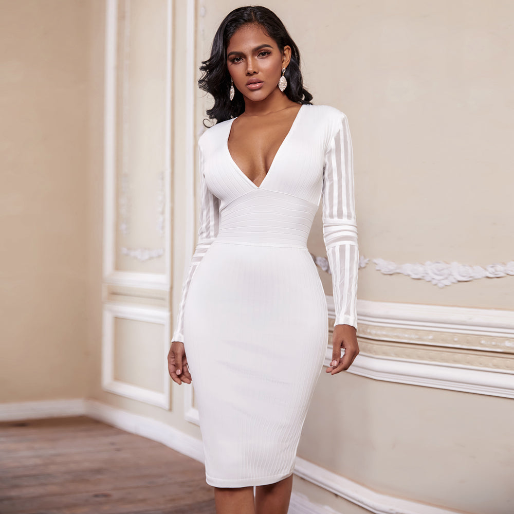 The Angel On Earth Midi Dress features a midi length cut, ribbed fabric and long sleeves. The V- neckline gives a bold yet feminine appearance. This dress comes in a classic white.