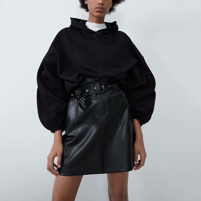 The Leather Girl Mini Skirt is a necessity for your new season wardrobe. This high waisted skirt features a faux leather fabric with ruched ruffles and a flattering belt. Team it with a simple high neck top and heels for a simple but chic combo.