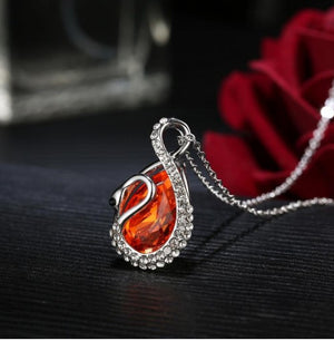 Orange Rhodium Plated CZ Stone Studded Pendant With Chain
