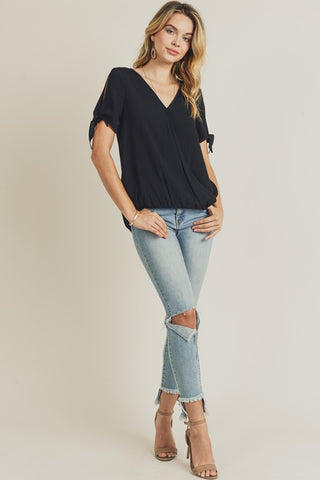 It's a good day surplice front tie sleeve top