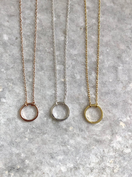 Classic Circle KarmaNecklace: available in silver, gold, and rose gold.