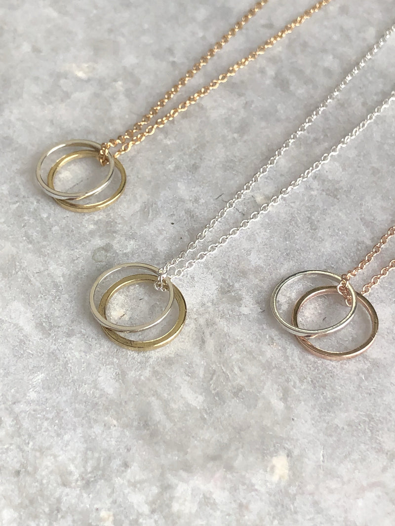 Double Karma Necklace: available in silver, gold, and rose gold.