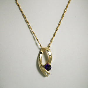 18KT Yellow Gold Amethyst And Diamond Pendant And Chain
