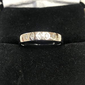 A Beautiful 14KT White Gold Diamond Band