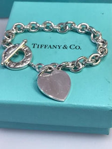 Tiffany & Co .925 Sterling Silver Heart Bracelet With Round Donut Toggle Close