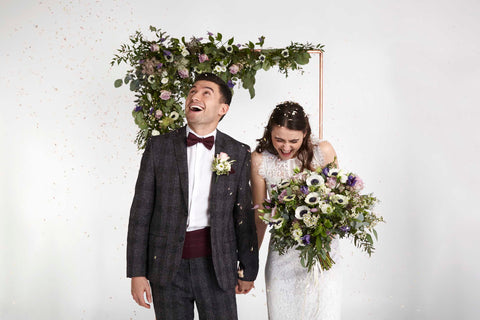 Bride & Groom with wedding flowers