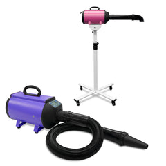 Vortex 5 dog grooming dryers shown in in pink on the vortex stand with rigid hands free hose fitted and also shown in purple by itself with the flexible hose and nozzle attached