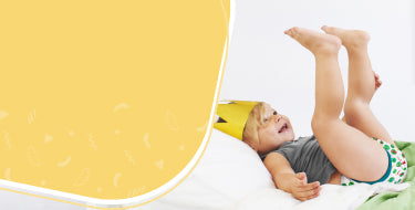 Toilet training tips block showing a toddler climbing onto a bed wearing training undies