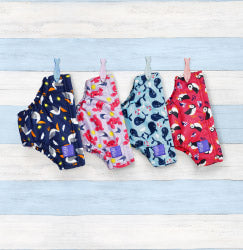 Four reusable swim nappies hanging in a row via pegs