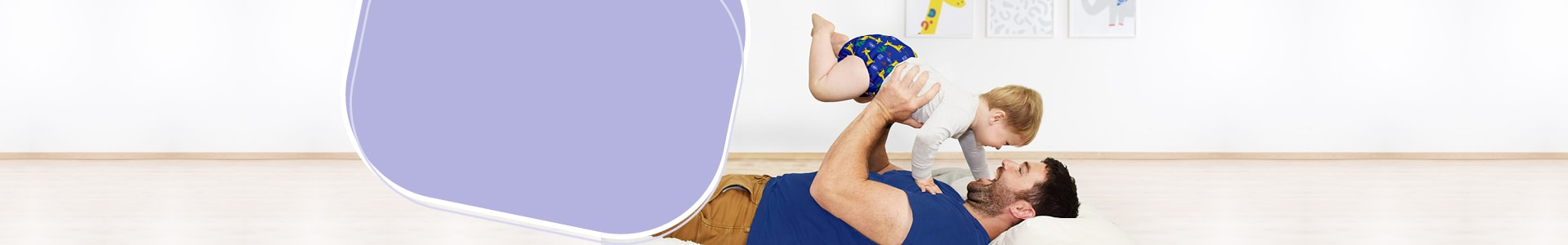 Bambino mio cloth nappies, dad laying down with baby