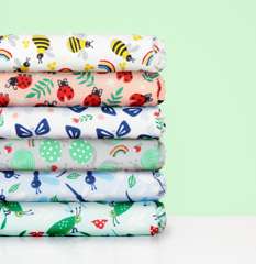 Stack of bug's life design cloth nappies