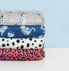 Stack of mioduo nappies in pet party designs