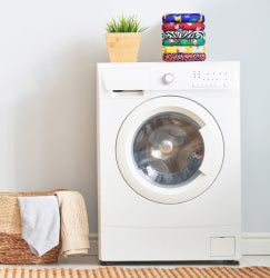 Washing machine with a stack of cloth nappies on top