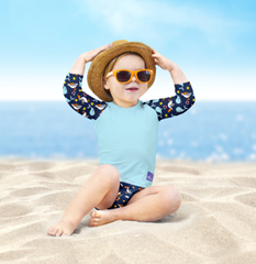 Baby wearing nautical and nice baby swimwear collection
