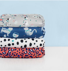 Bambino Mio pet party designs in a nappy stack
