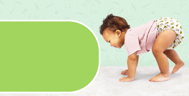 Cloth nappy week page banner with a baby crawling on hands and feet