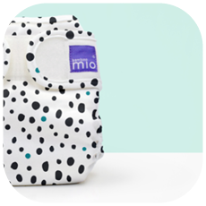 Half image of mioduo nappy cover in dalmation dots design
