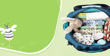 Out and about baby accessories page banner with an open change bag and accessories