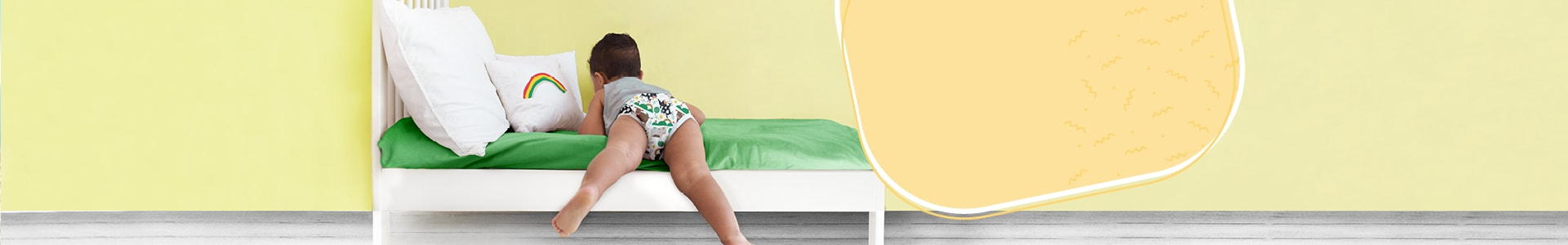 Bambino Mio toilet training tips page banner with toddler in training undies on a cot bed