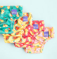 Four reusable swim nappies in Bambino Mio tropical punch designs