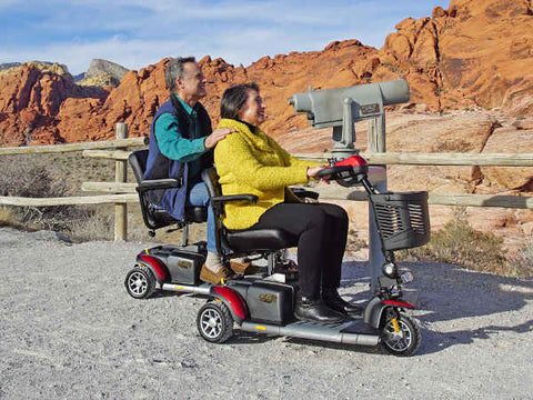 adult couple on electric mobility scooters sightseeing