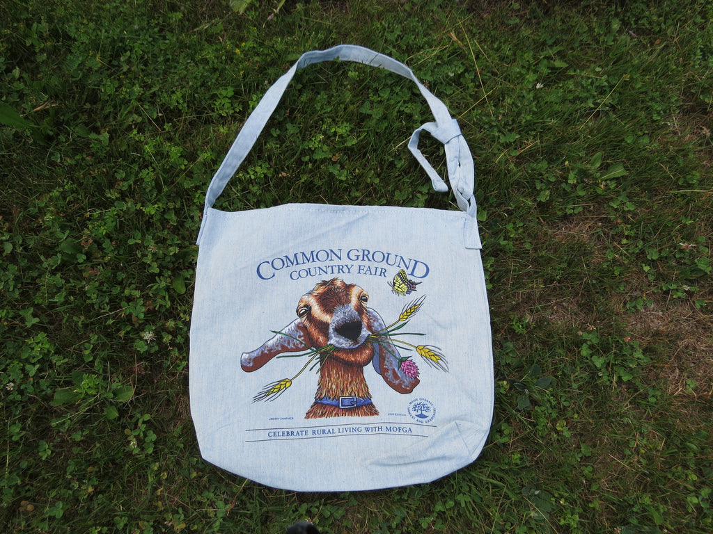 2015 Common Ground Country Fair Journey Bag. Joyful Goat Design. Color Stone Blue. Single adjustable cross-body strap.