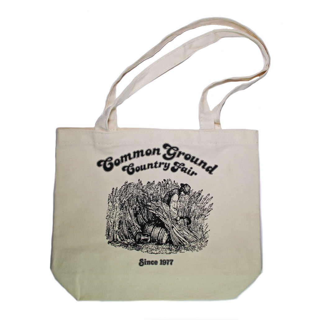 1980 Common Ground Country Fair reprint of small organic cotton tote bag. Farmer cutting wheat. Color white