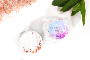 Peppermint and Pink Salts Bath Bomb. Refreshing, uplifting and floral, bursting with fragrant peppermint & rosemary essential oils. Turn the bath into a mini spa with a touch of Epsom and Himalayan salts,  whilst Kaolin Clay makes a creamy foam.  Handmade, vegan, palm oil and plastic free product. Gender neutral, suitable for sensitive skin .