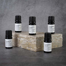 Load image into Gallery viewer, The full CAMPO Essential Oil Blend line. From left to right: Breathe, Focus, Energy, Relax, Sleep. All blends are in matching small black bottles.