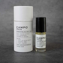 Load image into Gallery viewer, On the left: cylindrical packaging for the CAMPO Focus roll-on. The packaging is white and matches the label on the bottle, and has a pull-off cap. On the right: the same bottle as in the previous picture.