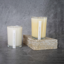 Load image into Gallery viewer, On the left: the Sera Summer in the Woods Candle. On the right: the Sera Scattered Light candle.
