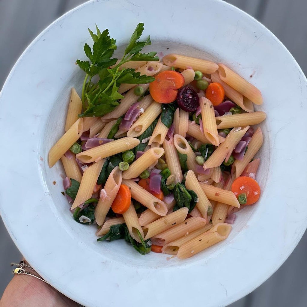 Penne pasta with carrots and peas