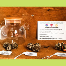 Load image into Gallery viewer, Gratefully Organic Artistic Flowering Tea - 100% Hand Made Blooming Flower Tea, One Bloom steeps 9-12 - 3.5 oz teacups Organic Tea Bags The Grateful Tea Co. Peace Love & Happiness (9 Flowering Balls)