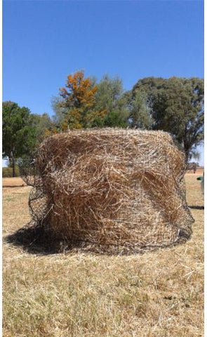 GutzBusta Slow Feed Hay Nets - fitting a hay net