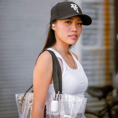 SOUL's influencer, @viamaeg is wearing a clear bag with her S-Gear clipped onto it and her headphones in her ear.