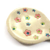 A Spoon holder with pastel flowers|כף לכף עם פרחי פסטל