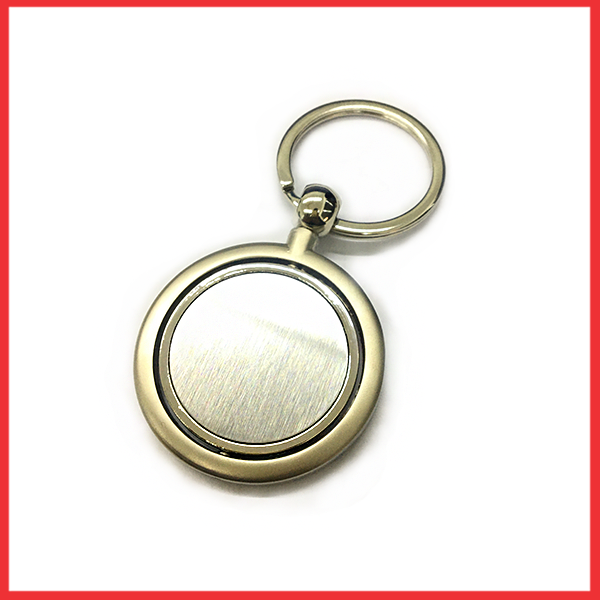 Silver And Metal Keychain With Round Silver Circle.