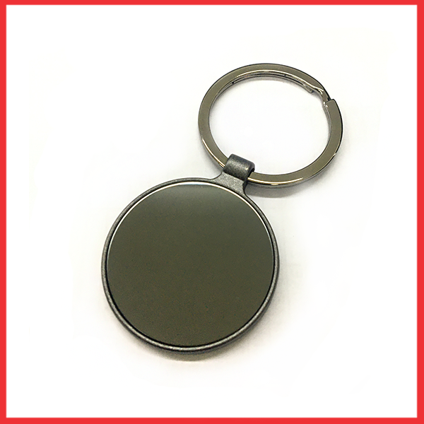 Silver And Plastic Keychain With Round Black Glass.